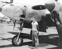 "Twenty-year old 1st Lt. William Fowkes of Port Charlotte, Fla. stands beside his favorite airplane in all the world, ""Billy's Filly,"" a P-38-L fighter he flew on 37 combat missions in the South Pacific during World War II. Photo provided by William Fowkes."