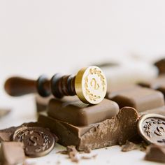 Chocolate seal monogram stamp photography by Ali Harper, styling Joy Thigpen via Once Wed