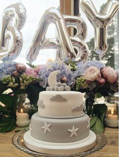 Unisex baby shower using blue Hydrangeas, pink peonies, white snapdragons and silver foil balloons. Everything was kept neutral in colour except for the flowers.