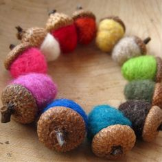 An even dozen felted wool acorns, in rainbow colors, for $24. I need a teensy wicker basket!