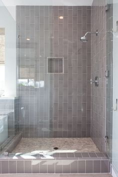 The gray subway tiles were laid vertically to add interest to the shower.