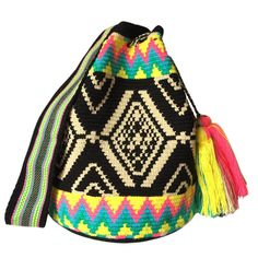 www.lombiaandco.com  The colors of this mochila Wayuu was inspired by the vivid colors that surround region of La Guajira. Sand, sea, desert, sun and a clear sky are constants in the landscape. Geometric figures are a signature ofthese mochila bags. #wayuubag Filet Crochet, Knit Crochet, Knitting Patterns, Crochet Patterns, Desert Sun, Tapestry Bag, Tribal Patterns, Clear Sky, Knitting Accessories