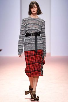 No. 21 | Spring 2015 Ready-to-Wear | 29 Grey striped long sleeve sweater and red/black checkered midi skirt