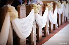 fabric swag down the aisle - easy and affordable pew decor