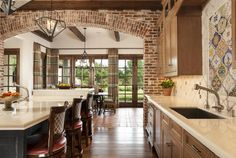 The exterior brick was used inside, seen here in the arched wall separating the kitchen from the Keeping Room.