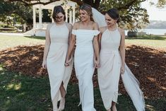 We are in awe of these beautiful bridesmaids in the Shona Joy High Neck Ruched Dress - Ivory