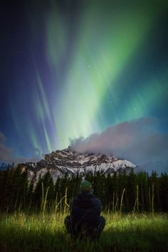 Selfies at night: Canadian photographer immerses himself in the wilderness - in pictures | Paul Zizka takes photos of himself in the wilderness of Canada. He began photographing night scenes but by adding himself into the shot he created a relationship between the central figure in the image and the nature around him. | Contemplating life at Cascade Meadows, Banff National Park. | Photograph: Paul Zizka Photography/Caters News Agency | 5 of 8