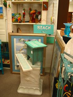 Dolphin table, beach signs and turquoise furniture, available today fro purchase 2/28 at Treasure Trove, Hudson, Fl.