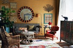 CALL OF THE WILD, animal prints used together, bold animal print round mirror , leopard settee, eclectic, global living room, painted chest, rattan chair
