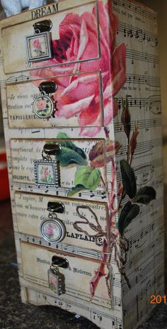 Decoupaged jewelry box with sheet music.  LOVE the jewelry charms as drawer pulls!! cw