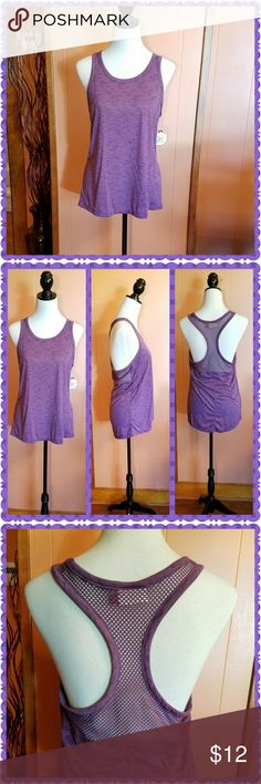 Purple racerback tank top This purple tank top is so cute. With a mesh back. Machine washable. SO Tops Tank Tops