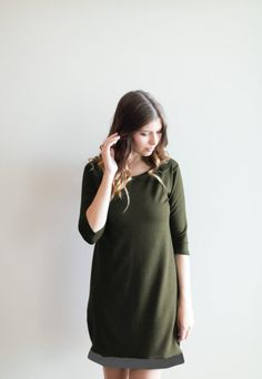 """*pre-sale*- Take me away tunic dress – olive/charcoal – ships in 4 to 6 weeks  $98.00    The """"Take me away tunic dress"""" is just begging for a relaxing holiday! Take this sweet dress to a summer at the cottage or for a quick trip to Vegas (you know you want to go). We are so excited for this fit, it is a comfortable loose fitting dress with a boat neck, half sleeve and the most adorable wooden button detail on each one. Made out of medium weight, incredibly soft bamboo/cotton blend French…"""