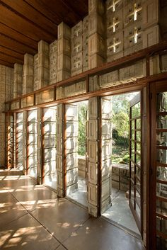 The Pleasures and Pitfalls of Frank Lloyd Wright Homes - WSJ.com Notice the concrete blocks let the light in, the cross-shapes above the doors....