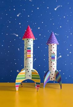 Customize this cool spacecraft with extra hatches, portholes, side fins, and more. To make one, roll a rectangle of scrapbook paper (ours is about 4 by 6 inches) into a cylinder, sealing the seam with washi tape. Cut four 1-inch-long slits into one end of the cylinder, spacing them evenly around the edge. Cut out two mustache-shaped fins (A). Fold them at a right angle as shown, and insert them into the slits (B). For the nose cone, cut out a half circle (ours is 41/2 inches in diame...
