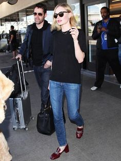 Kate Bosworth combines a pair of jeans and t-shirt with a Valextra Babila Shoulder Bag and Prada Bordeaux Patent Leather Tassel and Chain Detail Heel Loafers in Purple. Like her style?