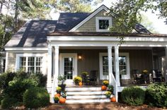 Front porch decorated for fall - love her cottage style home built from a Southern Living Plan Talk of the House.com