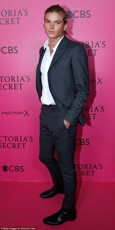 Model of good behaviour: Bad boy model Jordan Barrett looked angelic on the Victoria's Secret Fashion Show red carpet on Wednesday night