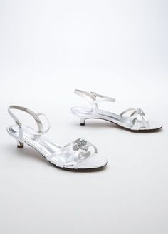 """These gorgeous sandals are the perfect example of understated elegance!  Sandals feature stunning rhinestone embellishment and ankle strap for extra support.  Heel measures 1 1/2"""".  Fully lined. Imported.  Dyeable shoes are sold in White as shown. Bring your dyeable shoes to your local David's Bridal Store to have them dyed in any of our exclusive colors About Dyeable Shoes."""