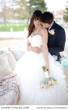 Beautiful white dress with pastel bouquet | Flowers: Classic Creations | Photographer: Janelle Photography