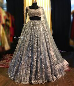 49a812a0759 Silver heavy flare ball gown Lehenga with white ostrich feathers on the  skirt. Silver beadwork blouse and net dupatta with ostrich feathers