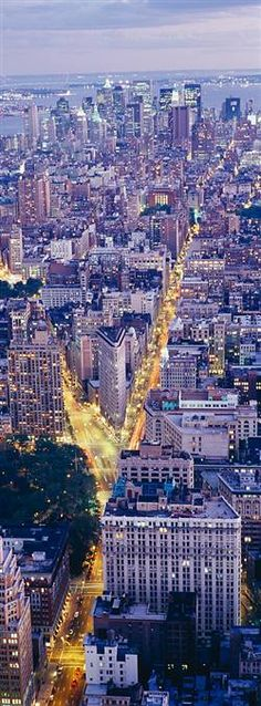 Aerial View of Manhattan Traffic | looking towards downtown/lower Manhattan; Flatiron bldg in center, 5th Ave running North/South (ending at Washington Square Park), Broadway cutting thru on the left.