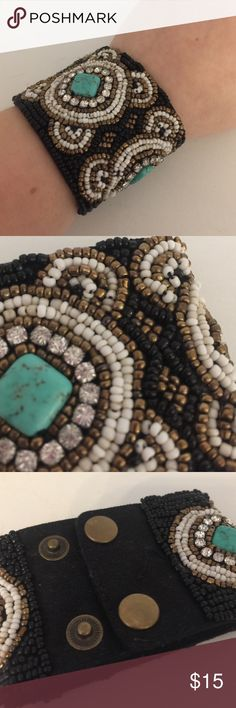 Beaded Cuff Bracelet Beaded Cuff Bracelet. Turquoise. Black, White, Gold. Two sized snaps. Wear is pictured. Jewelry Bracelets