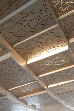 Perforated ceiling panels allow patterned light.  #CeilingDesign