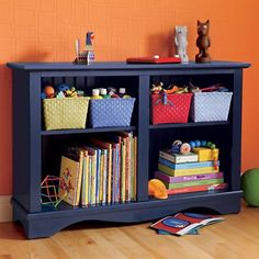 Kids Bookcases: Childrens Low Navy Blue Bookcase from The Land of Nod.  I like that my kids can store items on top and read them.