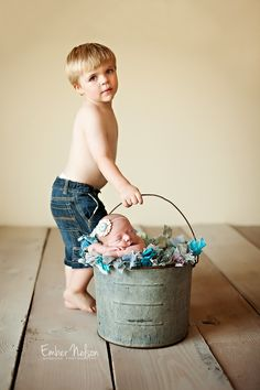 Gorgeous!......That would have to be a very well behaved older sibling to trust them not to swing the baby around.