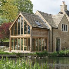 An oak wood and glass extension in Cirencester, Cotswolds. An oak wood and glass extension in Cirenc Oak Framed Extensions, House Extensions, Up House, House In The Woods, Cottage Extension, Oak Framed Buildings, Oak Frame House, Glass Extension, Building Extension