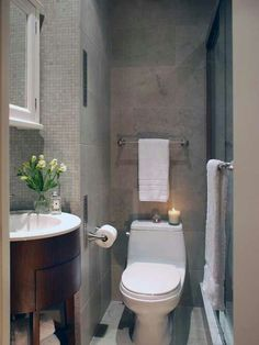 Small bathroom...grey and white with a pop of brown.