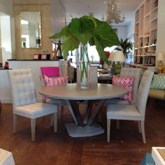 Pedestal breakfast #table nook design with bright #pink #ikat #toss #pillows #EastHampton #Mecox #interiordesign #Hamptons #MecoxGardens #furniture #shopping #home #decor #design #room #designidea #vintage #antiques #garden