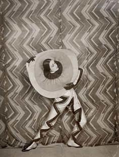 Wearing the Pierrot-Éclair costume designed by Sonia Delaunay, on the set of René Le Somptier's film Le P'tit Parigot, 1926