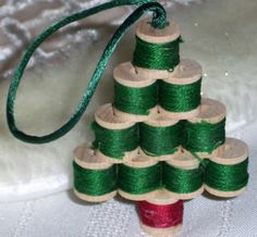 Wooden sewing spool Christmas tree ornament. I did this once, but wrapped cute tiny print Christmas material around each spool. It was cute too.