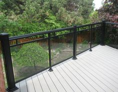 Check out our splendid variety of aluminum & glass railings for patios, decks & cottages, columns, gates, privacy panels and scenic topless glass railings. Balcony Glass Design, Glass Balcony Railing, Metal Deck Railing, Patio Railing, Balcony Railing Design, Roof Design, Balustrade Balcon, Balustrades, Outside Patio