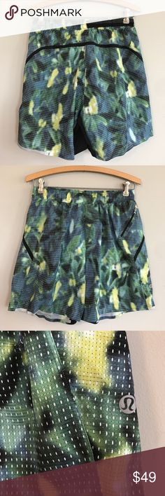 "Men's Lululemon Surge Shorts 7""SMESH EUC, no flaws, color code is FMWM, which is a multi-color jersey/mesh looking print with green, yellow, blue and black, drawstring, lightweight running shorts, four-way stretch Swift Ultra fabric, sweat-wicking liner, zippered pocket and reflective details, elastic waist measures 13.5"" across laid flat and inseam is 7"", stock photo is to show fit, actual shorts for sale are multi-colored print lululemon athletica Shorts Athletic"