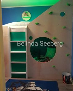bunkbed with climbing wall made out of plywood and creativity
