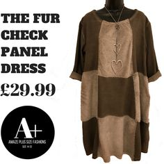 This beautifully textured plus size dress benefits from an attractive all over check design with luxury faux fur inserts. Featuring long sleeves, a scooped neckline and a generous cocoon shape to fit and all flatter all sizes. Pair with your favourite heels for a fabulous day to evening look!