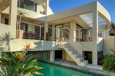 BAKOVEN BLUE, Bakoven Self Catering Accommodation Cape Town - De luxe 3-bedroom villa with welcoming living spaces and breathtaking views. Tiled balcony with 8-seater table and outdoor fireplace overlooking a sparkling swimming pool. Double garage plus off street parking for guests. Sleeps 6.