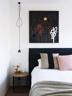 The Melbourne home of Mikayla Rose and family. Above – living room looking beyond to open plan dining area, the heart of the home. Artwork at left – 'Bronze Pop' by Rachel Castle, Black stool from Gre