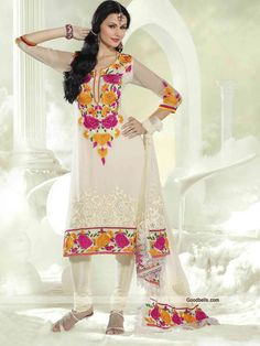 Get an enchanting look with this cream salwar kameez designed with embroidery. Beautiful floral pattern thread work seems pretty and enhancing its beauty. It will look good for semi-formal parties.