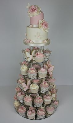 Cupcake tiers with small cake - could have lots of different flavours then (more for me to sample then, oh well!)