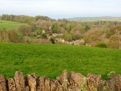 The beautiful village of Upper Slaughter, surrounded by rolling hills and stunning countryside.
