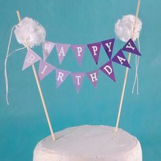 Lavender to purple ombre Happy Birthday cake bunting banner. Banner made from cotton fabrics in lavender to purple ombre. Cake banner has white