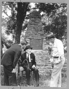 Old Confederate veteran at a memorial erected to the last shot fired in the Civil War (east of the Mississippi).  It would seem maybe the old vet is relating the details of the incident to the two young listeners.