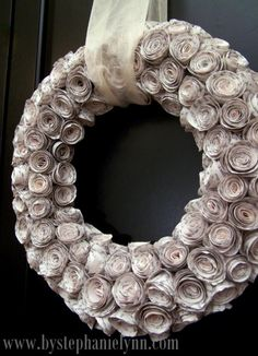 http://inspirationnotebook.wordpress.com/2010/11/29/crafy-rolled-recycled-book-page-wreath/