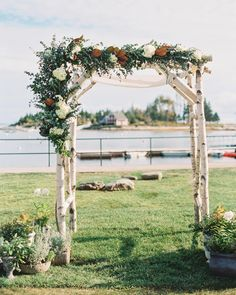 These grooms chose a Watershed Floral chuppah made from birch branches and embellished with magnolia leaves, hydrangeas, blackberry branches, and eucalyptus.