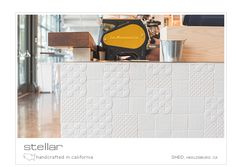 A crisp white glaze makes this hand made deco field tile from Sonoma Tilemakers fresh and modern