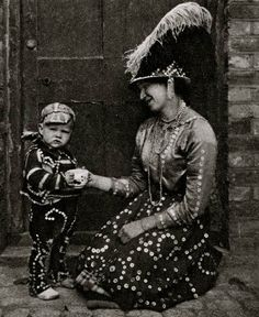 Pearly Kings and Queens of East End..a fixture! Costermonger and child. Characterful portraits of Londoners, believed to be by photographer Donald McLeish (1879-1950), selected from the three volumes of Wonderful London edited by St John Adcock and produced by The Fleetway House in the nineteen-twenties.