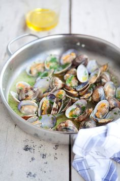 Sauteed clams in garlic and fresh herbs add some angel hair pasta!